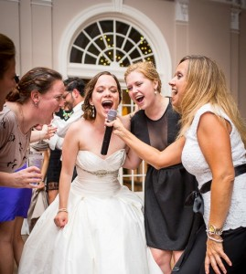 bride-and-friends-singing-at-wedding-reception